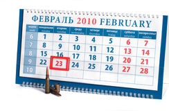 Defenders Day. Calendar with date on February, 23rd, day of the defender of fatherland to Russia, and cartridges on a white background Royalty Free Stock Photography
