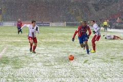 Defenders miss striker Stock Photos