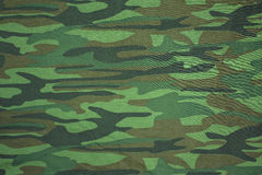 Defenders. Spotty camouflage coloring used to reduce the visibility of people, weapons, machinery, and structures due to the breaking of the silhouette of the Royalty Free Stock Photos