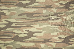 Defenders. Spotty camouflage coloring used to reduce the visibility of people, weapons, machinery, and structures due to the breaking of the silhouette of the Stock Photography