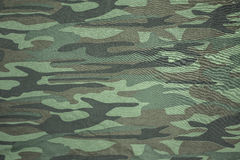 Defenders. Spotty camouflage coloring used to reduce the visibility of people, weapons, machinery, and structures due to the breaking of the silhouette of the Royalty Free Stock Images