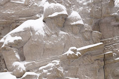 Defenders of Stalingrad on a bas-relief of Stock Image