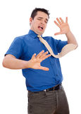 Defending. Business man with flying tie defending himself - front view royalty free stock image