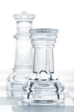 Defending queen. Chess rook is defending queen, cut out from white royalty free stock image
