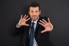 Defending for something. Fearful businessman defending for something stock images
