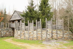 Defending system in open-air museum. Open-air museum with traditional defending system made from wood and stones - entrance gate and walls in Prasily, Sumava stock images