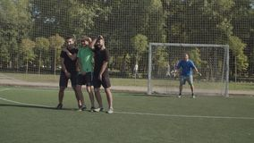 Defending team forming a wall to block free kick. Football defending team forming a wall to block direct free kick under coommands of goalie during soccer game stock video