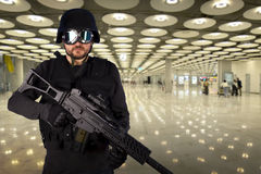 Defense against terrorism. A soldier in an airport Stock Photography