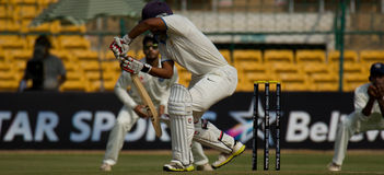 Defense Batting. A batsman play a defensive shot during the ongoing Irani Cup game in Bangalore royalty free stock photo