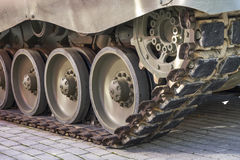 Defense, Military tank, detail of tracks or wheels of the off-road armored vehicle royalty free stock photography