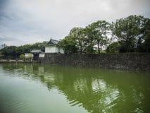 Defense moat at Imperial Palace, Tokyo. Defense water moat at the Imperial Palace gardens, Tokyo, Japan Stock Photo