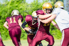 Defense after pass at American Football Game Stock Image