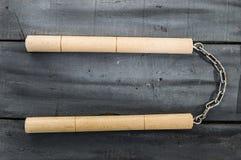 Defense sports equipment and supplies, kung fu and nunchaku, martial arts and nunchaku shaking.  Royalty Free Stock Photos