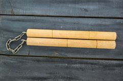 Defense sports equipment and supplies, kung fu and nunchaku, martial arts and nunchaku shaking.  Stock Images
