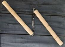 Defense sports equipment and supplies, kung fu and nunchaku, martial arts and nunchaku shaking.  Stock Photography