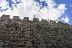 Defense, Stone walls of a medieval castle. Town of Consuegra in Royalty Free Stock Photography