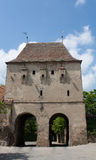 Defense tower with gates. One of the defense towers from the citadel located in Sighisoara, Romania. It was two gates Royalty Free Stock Photography