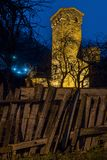Defense tower and old wooden fence at night. Road trip traveling through georgia defense tower and old wooden fence at night royalty free stock photography
