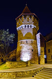 Defense tower in sibiu at night. Defense tower in sibiu, romania, at night Royalty Free Stock Image