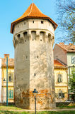 Defense tower in Sibiu. Slightely degraded defense tower on the Cetatii Street in Sibiu Stock Images