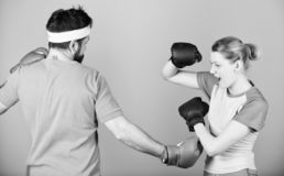 Defense wins championships. punching, sport Success. sportswear. Fight. Happy woman and bearded man workout in gym royalty free stock photography
