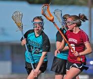 Defensie 02 van de Lacrosse van meisjes Stock Afbeeldingen