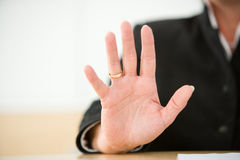 Defensive demeanor. Woman on a business meeting in a defensive demeanor Royalty Free Stock Image