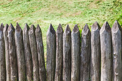 Defensive fence sharp logs Royalty Free Stock Image