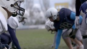 American football. The defensive and offensive lines of two football teams meet at the line of scrimmage. Close up of. The defensive and offensive lines of two stock footage