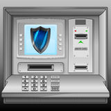 Defensive shield on cash machine blue screen  Royalty Free Stock Photos