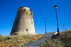 Defensive tower with stairs. Spanish defensive tower and stairs entrance. Lagos near Malaga royalty free stock photography