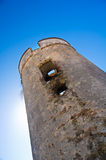 Defensive tower with sun behind. Destructed spanish defensive tower with sun behind. Lagos near Malaga Stock Images