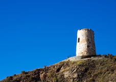 Defensive tower in sunbeams. Spanish defensive tower in sunbeams, El Morche near Malaga Royalty Free Stock Photos