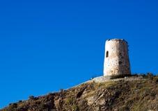 Defensive tower in sunbeams. Spanish defensive tower in sunbeams, El Morche near Malaga royalty free stock photos