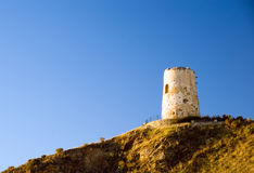 Defensive tower at sunset. Spanish defensive tower at sunset, El Morche near Malaga Royalty Free Stock Photos