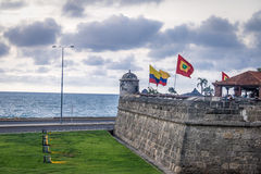 Defensive wall with Colombian and City Flags - Cartagena de Indias, Colombia Stock Image