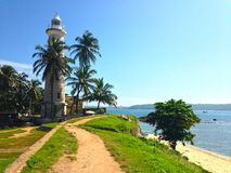 Defensive wall fortress Fort Galé, ocean and lighthouse Stock Photos