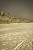 Defensive wall of  old castle on snow background retro Stock Photography