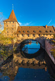 Defensive wall-old city- Nuremberg, Germany. Defensive wall-Kettensteg iron bridge- river Pegnitz- old town- mirror image- Nuremberg, Germany stock photography