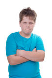 Defiant boy in blue - isolated on white Royalty Free Stock Images