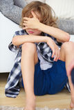 Defiant boy holding hand over his eyes Royalty Free Stock Photography