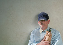 Defiant homeless man. A homeless man clutching a wine bottle Stock Photography