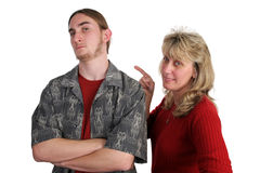 Defiant Teen Angry Mom. A defiant teen boy and his angry mother Stock Photos