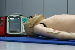 Defibrillator and CPR dummy doll Stock Photography