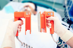 Defibrillator electrodes in hands Royalty Free Stock Photos