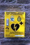 Defibrillator life saving equipment yellow box Royalty Free Stock Photo