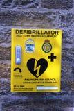 Defibrillator life saving equipment yellow box Royalty Free Stock Photo