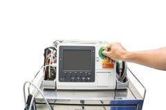 Defibrillator und cliping Weg DES AED EKG- oder ECG-Monitors Stockbilder