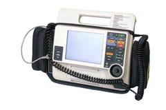 Defibrillatore moderno dell'VEA isolato su bianco fotografie stock