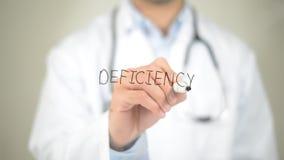 Deficiencia, escritura del doctor en la pantalla transparente Imagen de archivo libre de regalías